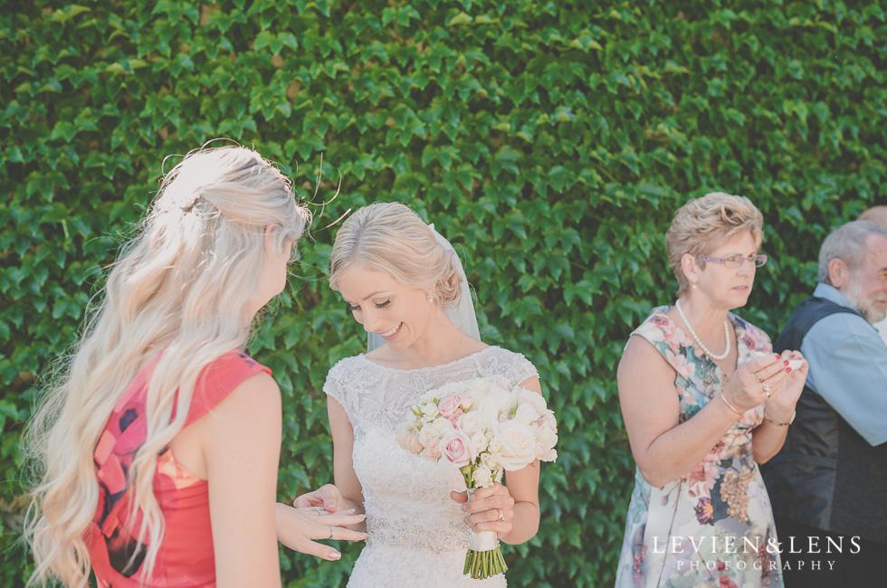 bride look at engagement ring {Tauranga-Bay of Plenty wedding-couples-engagement photographer}
