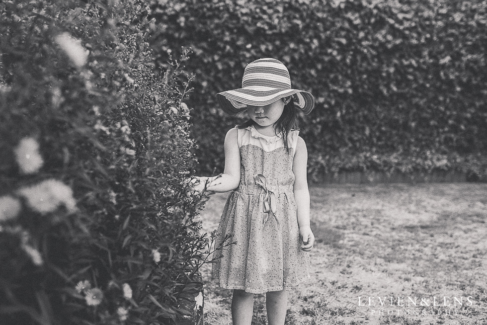 girl near flowers {Hamilton family-kids-newborn lifestyle photographer}