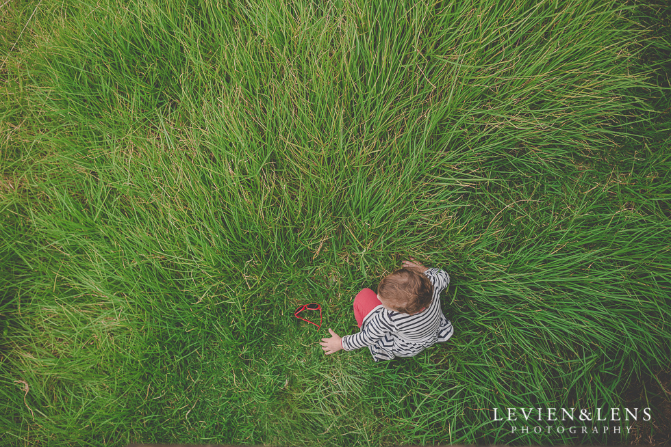 girl in long grass North Head {Auckland lifestyle wedding photographer}