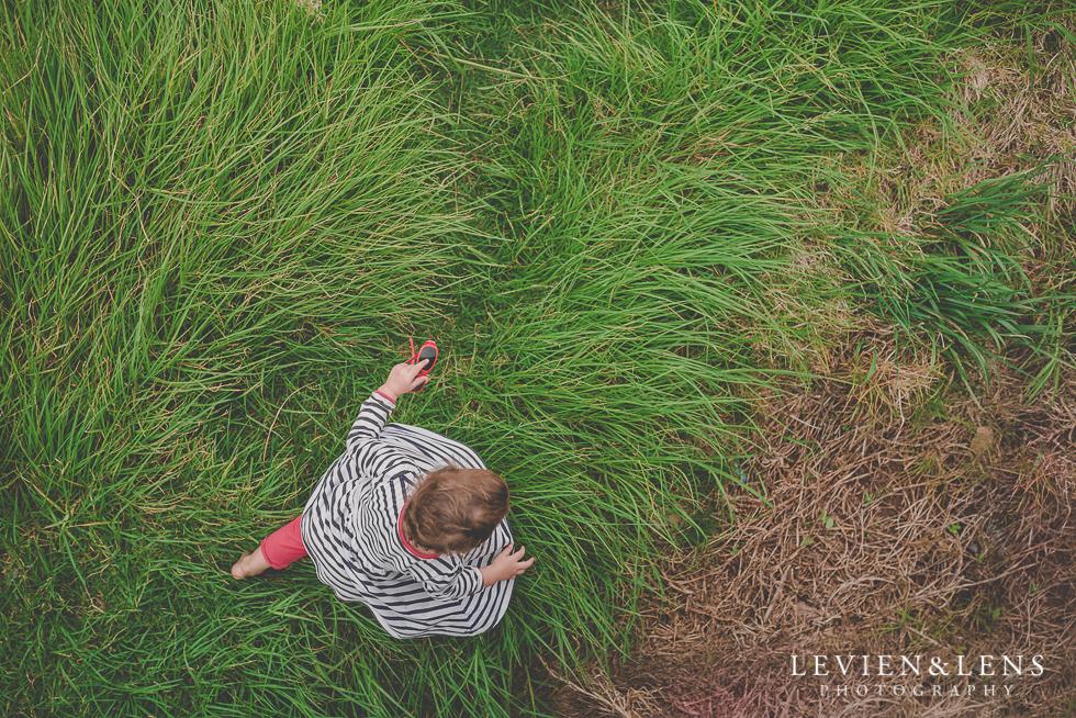 girl in grass North Head {Auckland lifestyle wedding photographer}