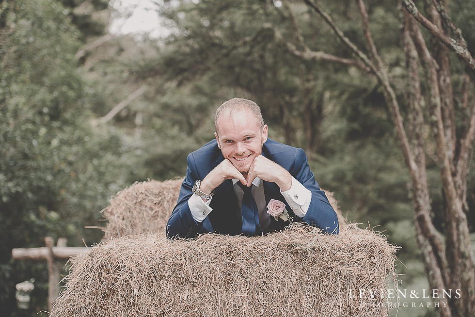 groom on hay guests {Auckland-Hamilton-Tauranga wedding photographer}