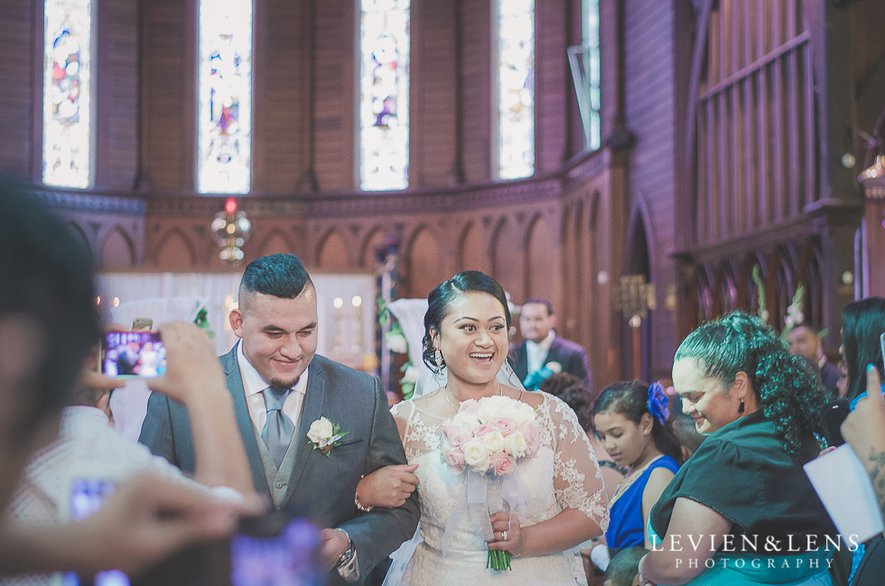 bride and groom walking down aisle Church Of The Holy Sepulchre - Bastion Point {Auckland NZ lifestyle wedding-engagement photographer}