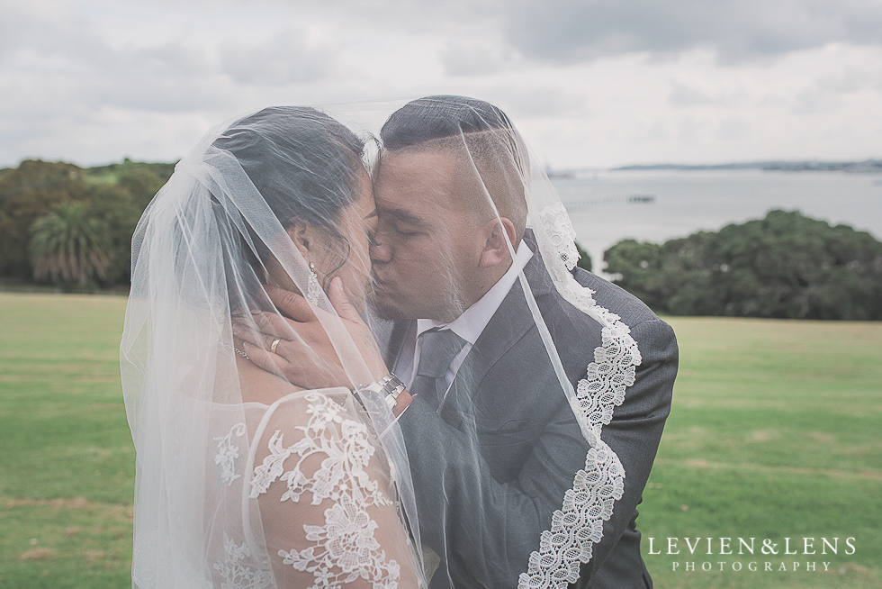 bride and groom under veil Church Of The Holy Sepulchre - Bastion Point {Auckland NZ lifestyle wedding-engagement photographer}