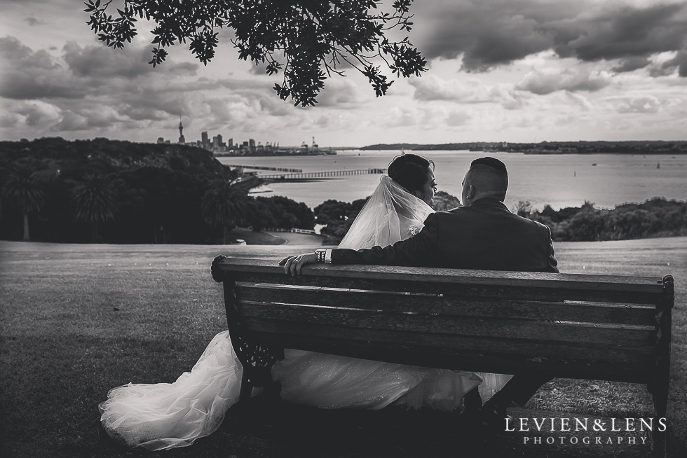 bride and groom sitting on bench Church Of The Holy Sepulchre - Bastion Point {Auckland NZ lifestyle wedding-engagement photographer}