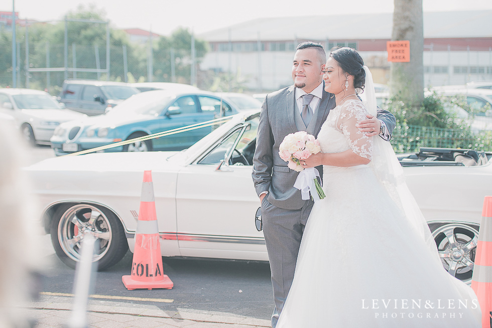 stunning couple next to car Church Of The Holy Sepulchre - Bastion Point {Auckland NZ lifestyle wedding-engagement photographer}