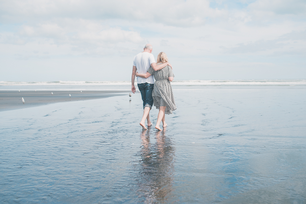 mum and dad walking - Kariotahi beach photo shoot {Auckland lifestyle family-kids photographer}