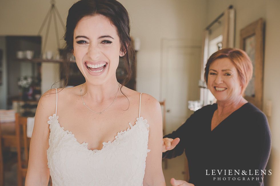 brides laughing at getting ready St Margarets Cafe - Karaka {Auckland lifestyle wedding photographer}