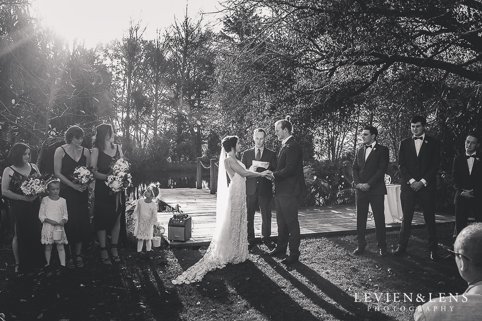 bride and groom holding hands ceremony St Margarets Cafe - Karaka {Auckland lifestyle wedding photographer}