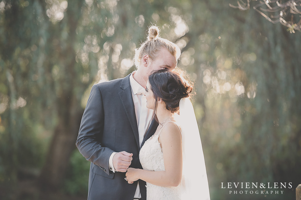 bride and groom intimate moment at signing register St Margarets Cafe - Karaka {Auckland lifestyle wedding photographer}