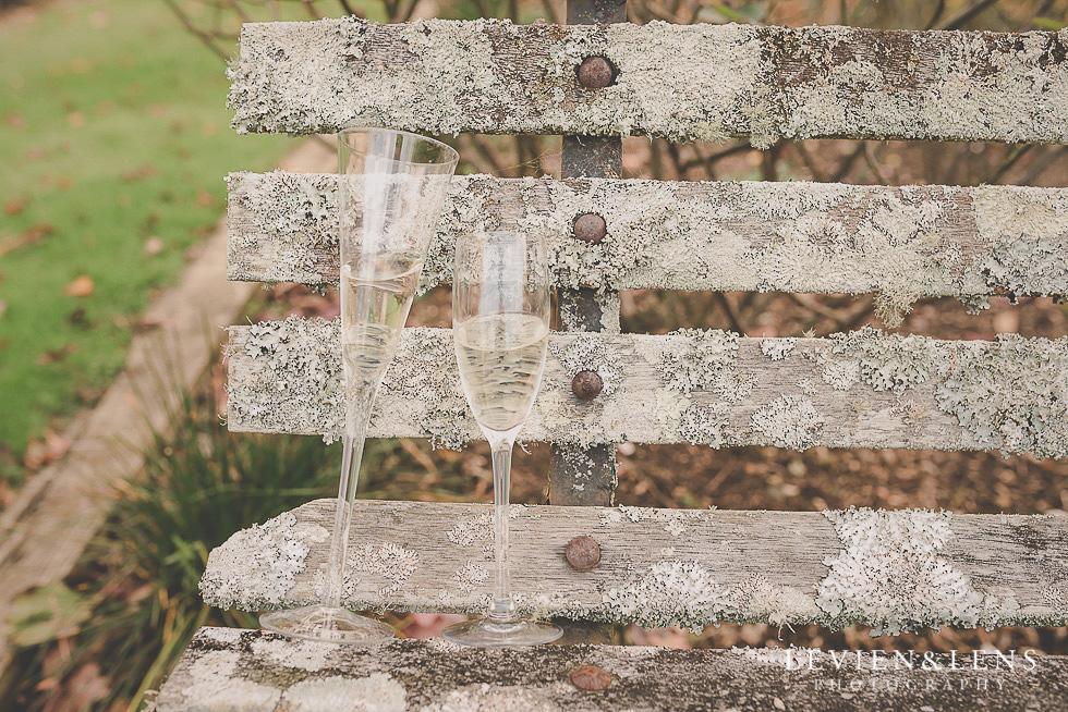 champaign glasses on the bench St Margarets Cafe - Karaka {Auckland lifestyle wedding photographer}