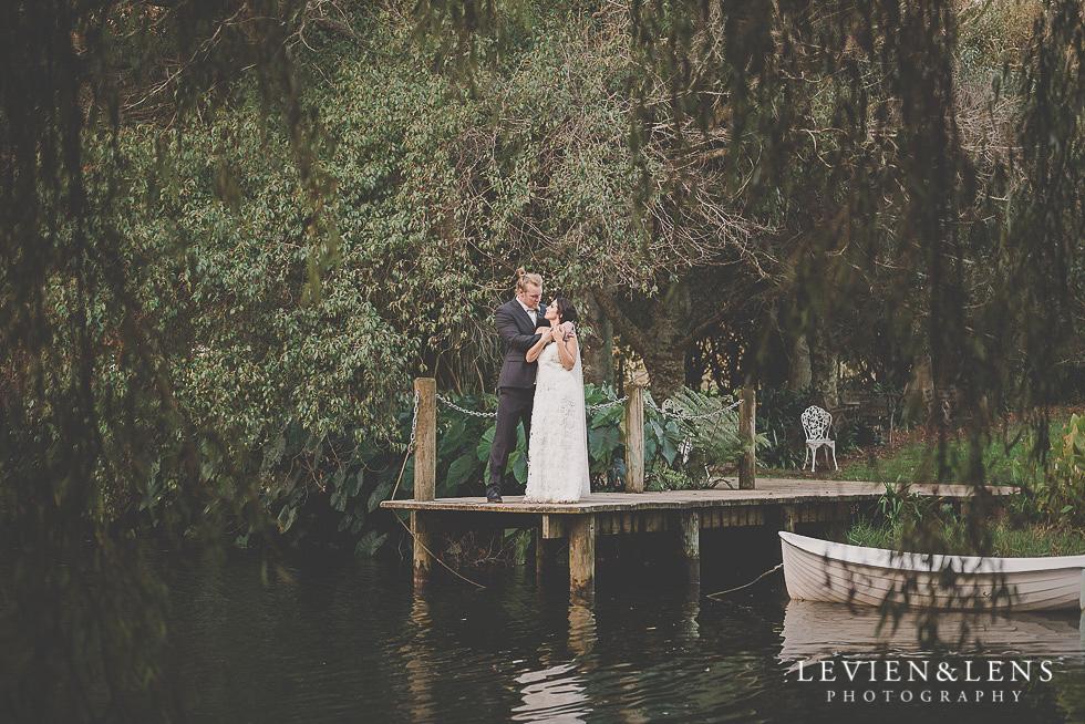 bride and groom near lake St Margarets Cafe - Karaka {Auckland lifestyle wedding photographer}