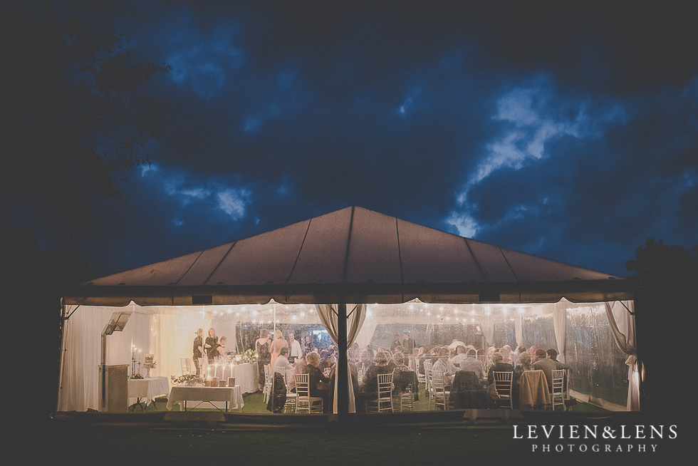 reception marquee from outside - night photography St Margarets Cafe - Karaka {Auckland lifestyle wedding photographer}