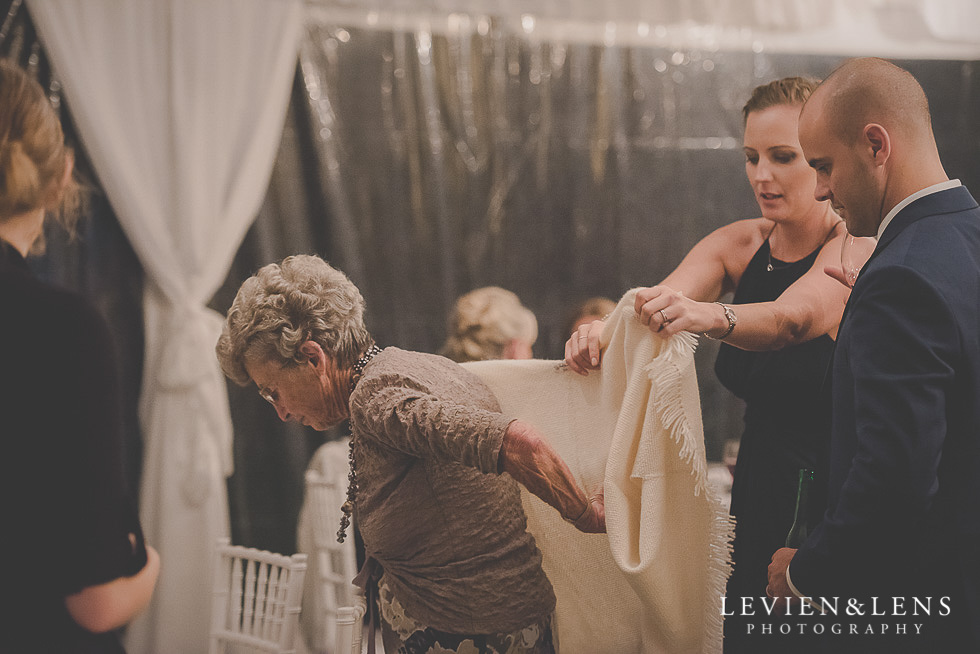 guests helping grandma at reception St Margarets Cafe - Karaka {Auckland lifestyle wedding photographer}