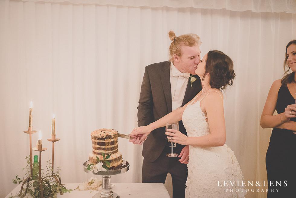 cake cutting - reception St Margarets Cafe - Karaka {Auckland lifestyle wedding photographer}