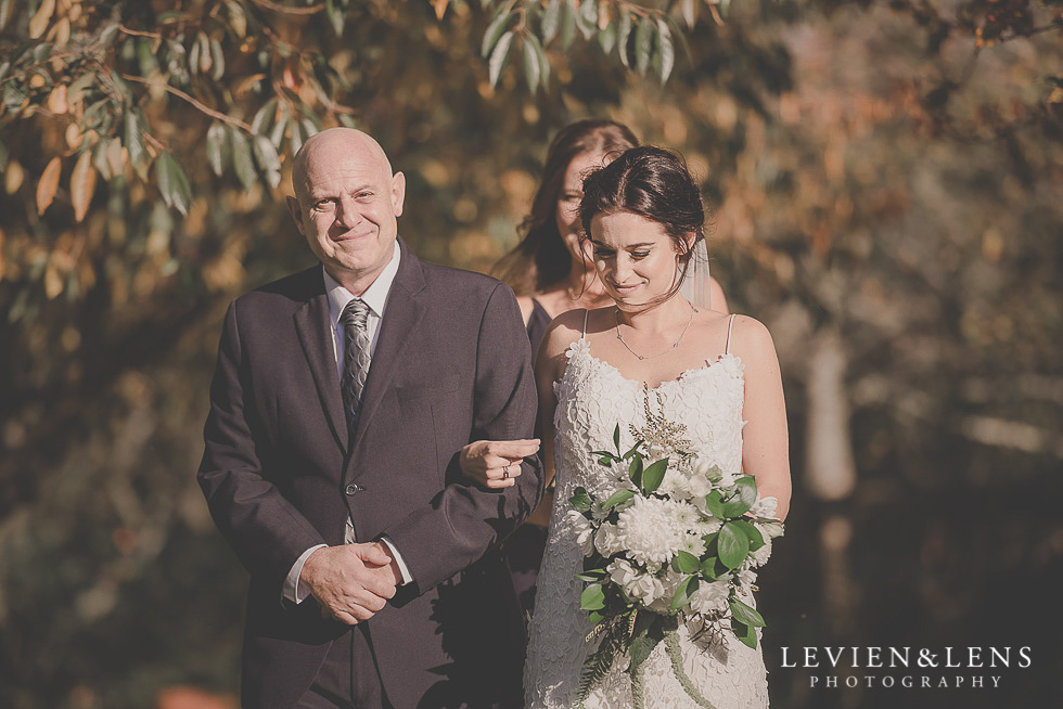 bride with dad walking down aisle St Margarets Cafe - Karaka {Auckland lifestyle wedding photographer}