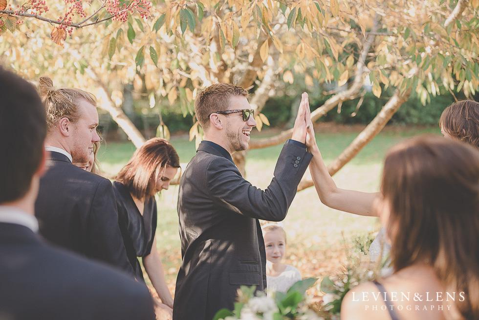 candid moments after ceremony St Margarets Cafe - Karaka {Auckland lifestyle wedding photographer}