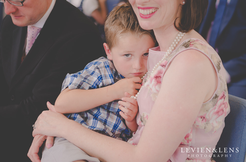 mum with son at ceremony - best wedding photos {Auckland New Zealand couples photographer}