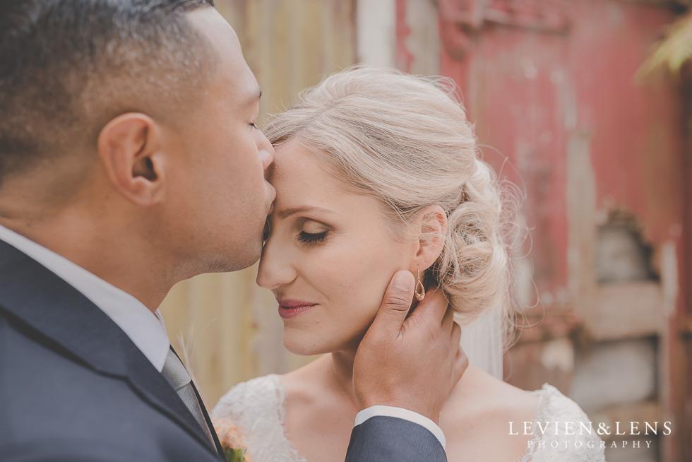 bride and groom kiss forehead - best wedding photos {Auckland New Zealand couples photographer}