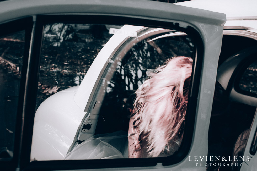 bride sitting in retro car - Cornwall park photo session - winter wedding {Auckland NZ lifestyle weddings photographers}