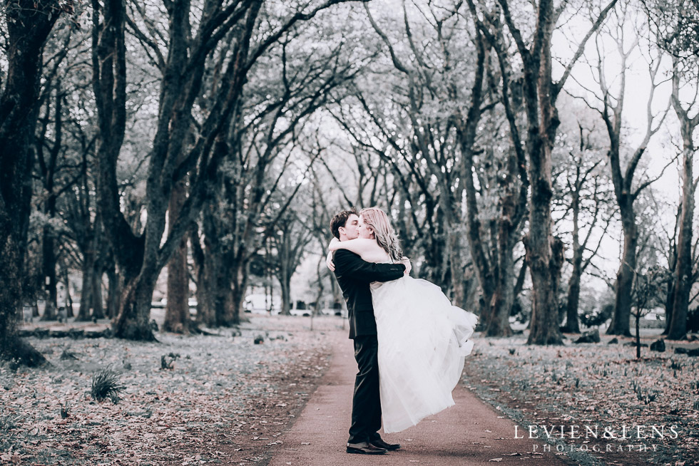bride and groom twirl at alley - Cornwall park photo session - winter wedding {Auckland NZ lifestyle weddings photographers}
