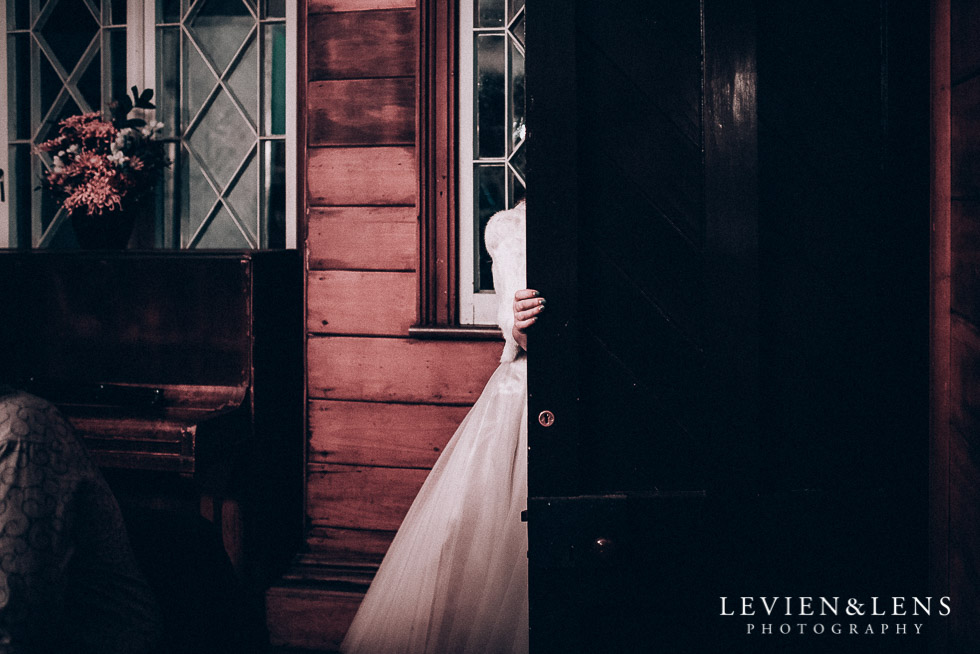 bride at reception walking in door - Highwic historic house-museum winter wedding {Auckland NZ lifestyle weddings photographer}