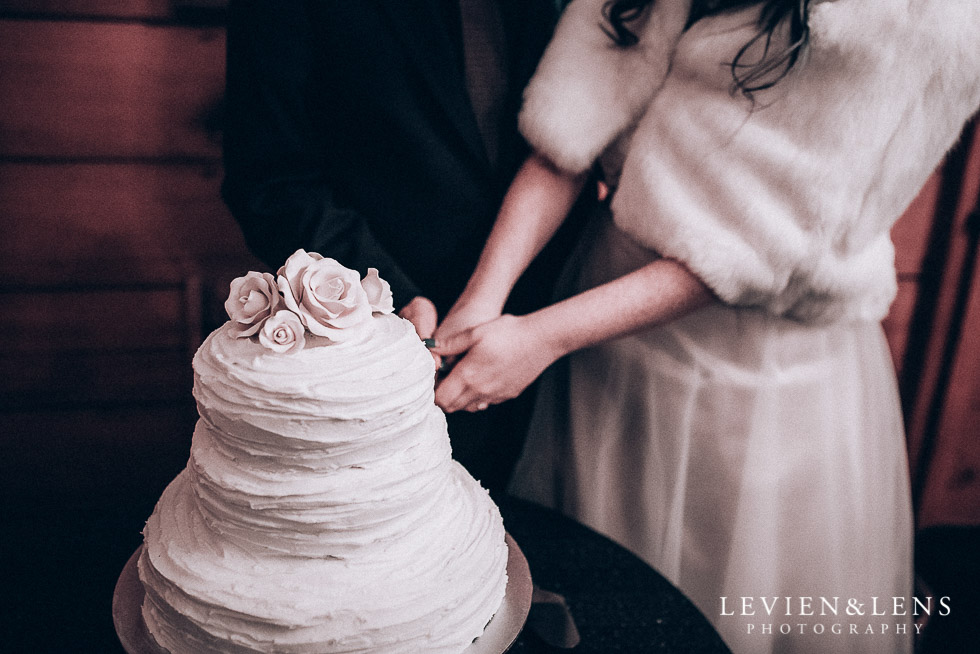 cake cutting - reception Highwic historic house-museum winter wedding {Auckland NZ lifestyle weddings photographer}