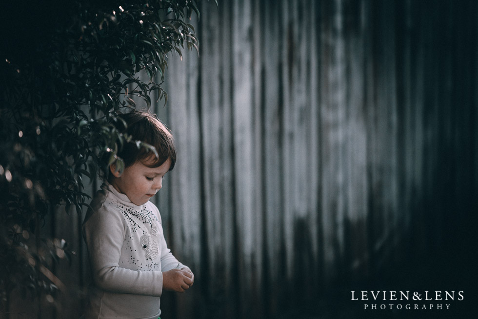 girl standing near fence August {Hamilton-Taupo lifestyle wedding photographer}