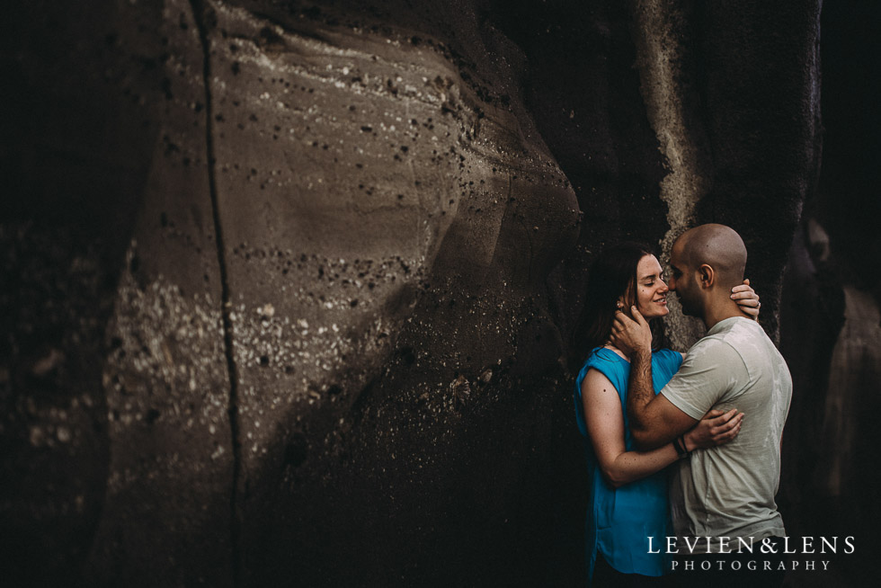near the rocks - Muriwai Beach couples-engagement photo shoot {Auckland wedding photographer}
