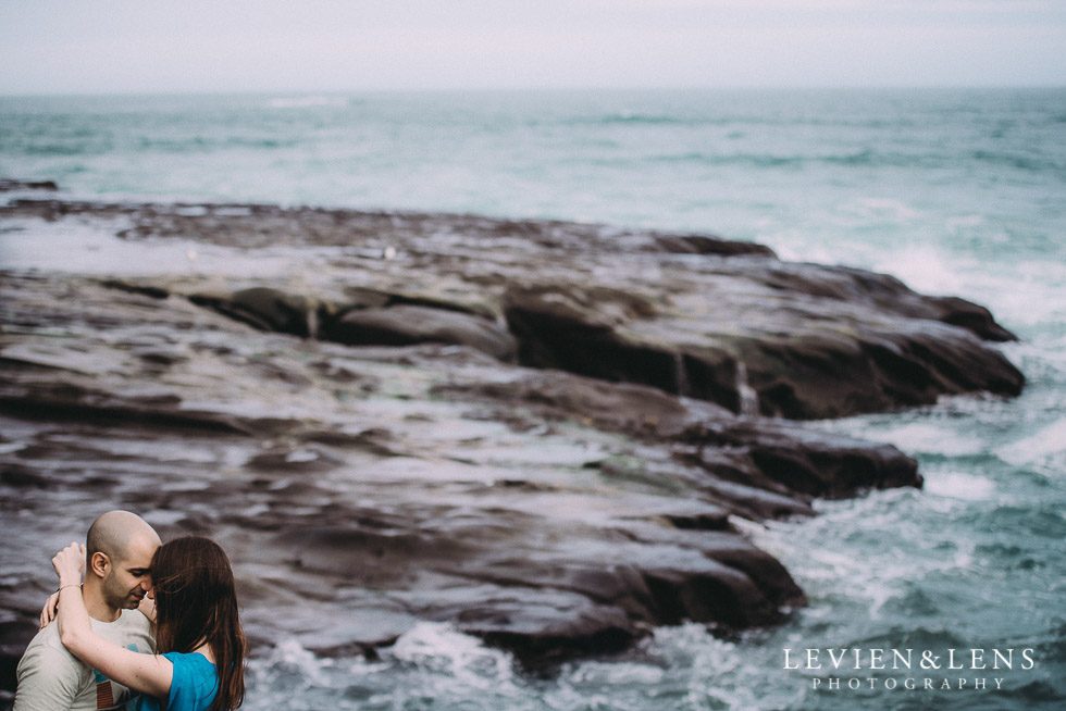 waves and rocks - Muriwai Beach couples-engagement photo shoot {Auckland wedding photographer}