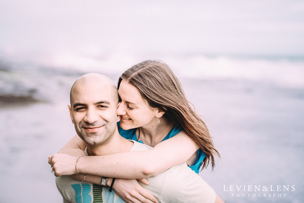 jump on - Muriwai Beach couples-engagement photo shoot {Auckland wedding photographer}