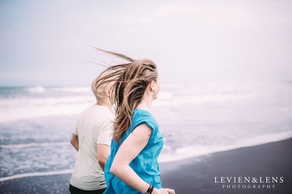 run on black sand - Muriwai Beach couples-engagement photo shoot {Auckland wedding photographer}