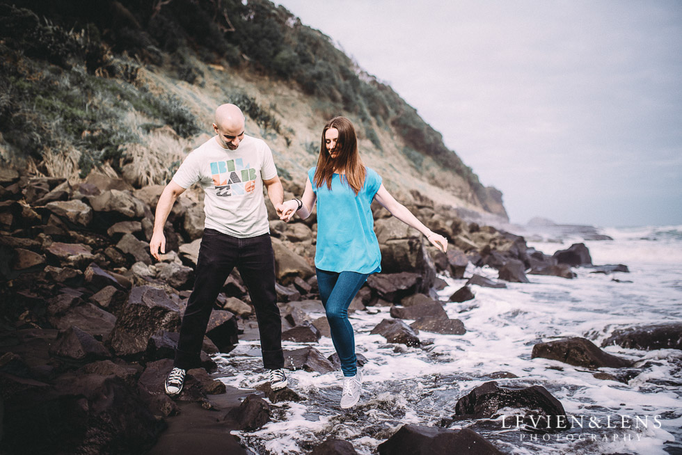 jump in the waves {Auckland couples-engagement photographer} Muriwai beach