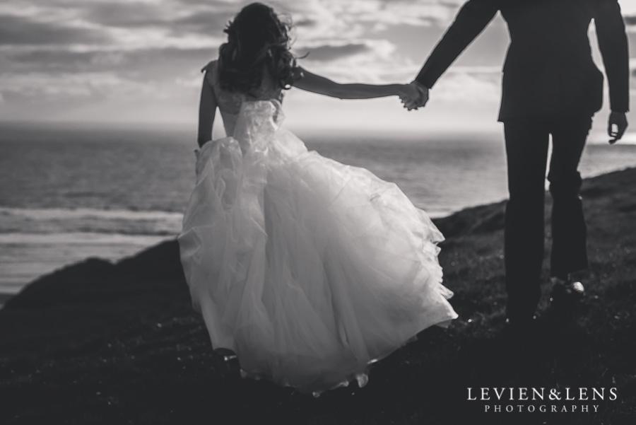 couple walking on the beach {Auckland wedding photographer}