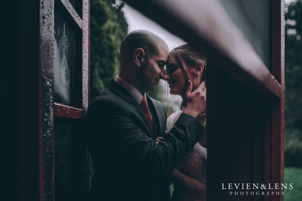 bride and groom in red phone box - Markovina Vineyard Estate - Kumeu {Auckland wedding photographer}