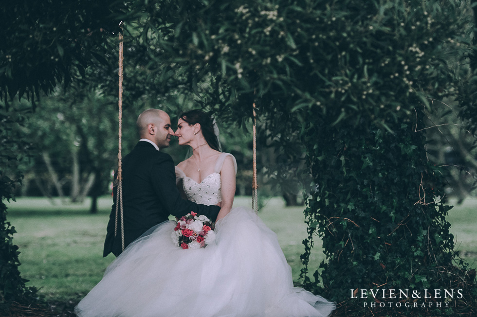 bride and groom on swing - Markovina Vineyard Estate - Kumeu {Auckland wedding photographer}