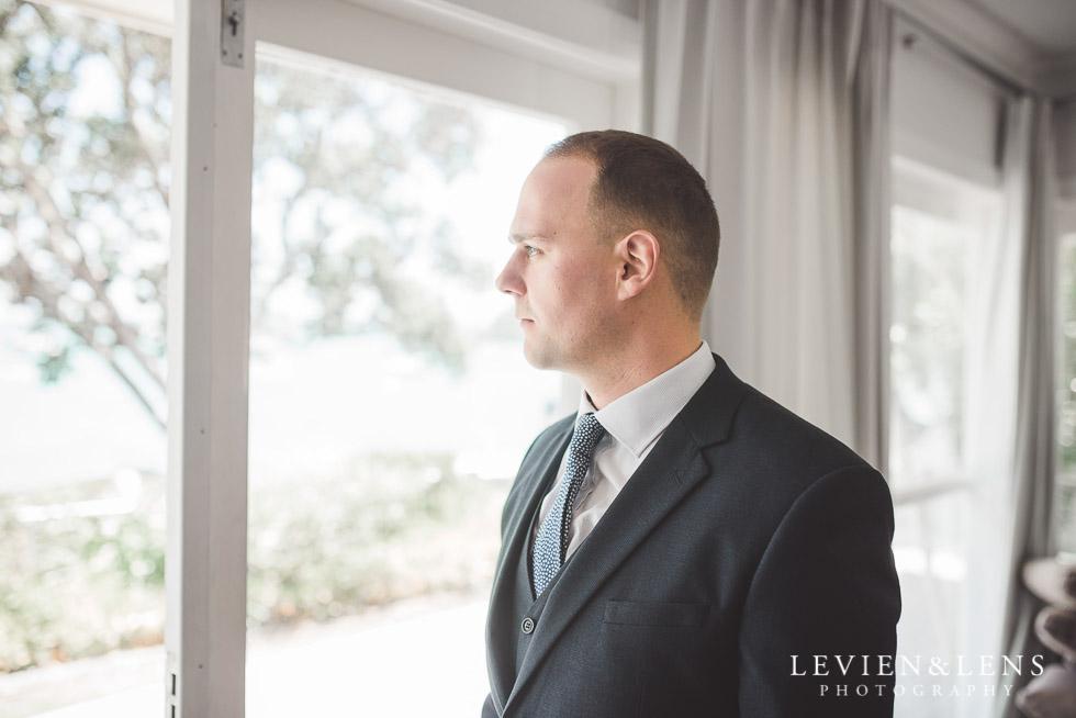 groom near window - The Duke of Marlborough Hotel - Russell wedding {Northland-New Zealand weddings photographer}
