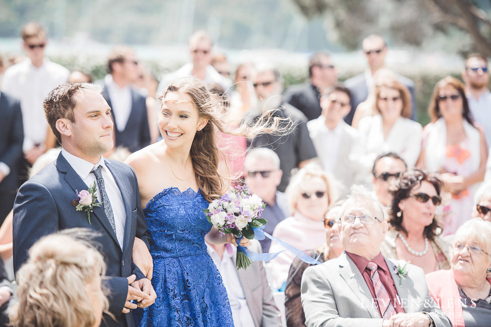 bridesmaid and groomsmen walking down aisle - The Duke of Marlborough Hotel - Russel wedding {Northland-New Zealand weddings photographer} Pompallier Mission Garden