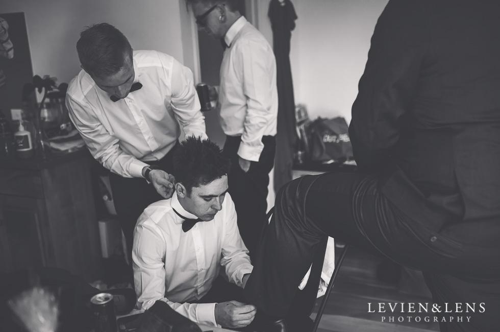 groom with groomsmen getting ready - New Zealand wedding photographer