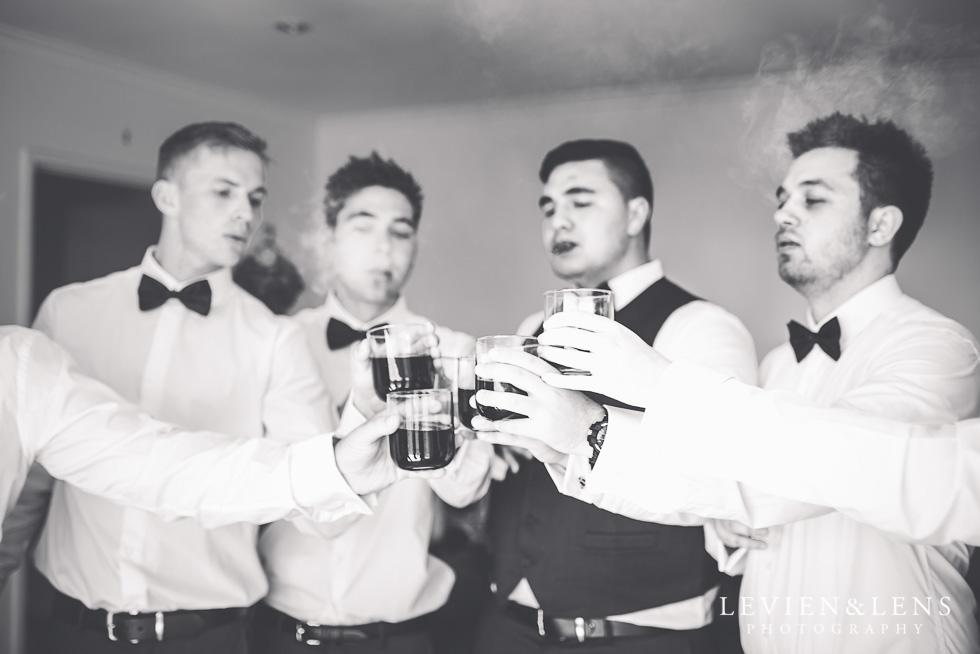 groom with groomsmen - New Zealand wedding photographer