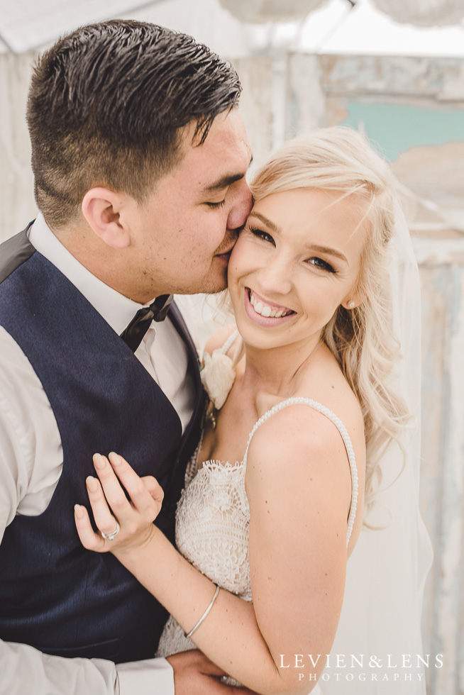 bride and groom near rustic doors {Auckland wedding photographer}