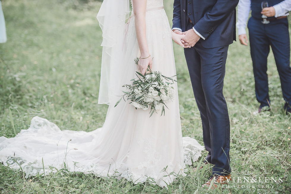 bride and groom holding hands - bride and groom with horses - Old Forest School Vintage Venue {Tauranga - Bay of Plenty wedding photographer}