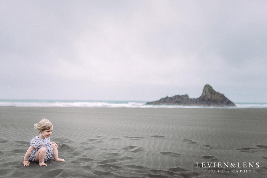 kid on sand - Karekare Beach post-wedding | elopement photo shoot {Auckland NZ couples-weddings photographer}