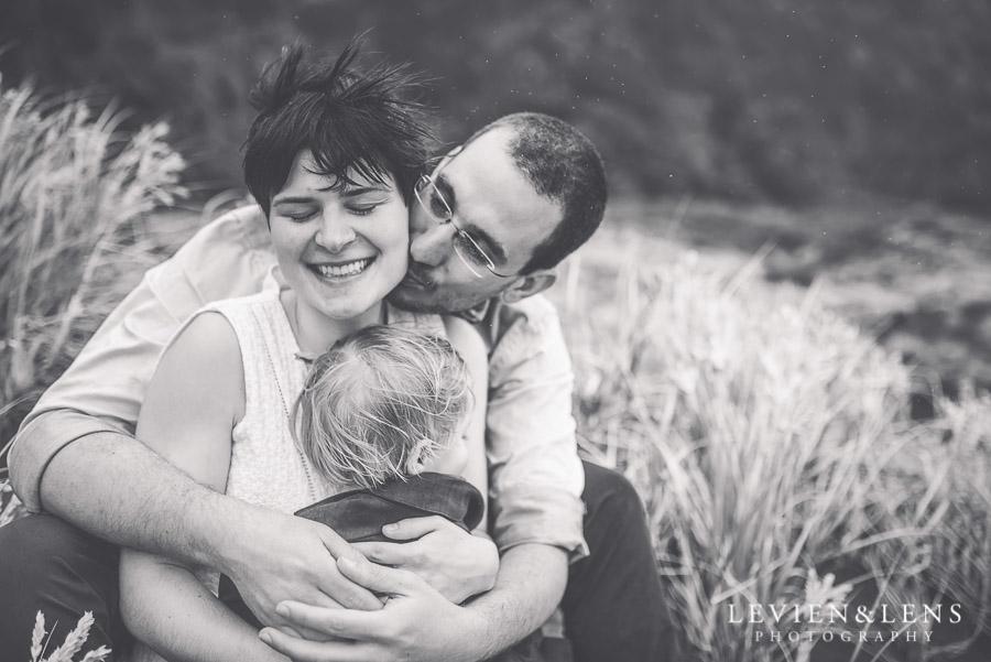 tender kiss moment - Karekare Beach post-wedding | elopement photo shoot {Auckland NZ couples-weddings photographer}