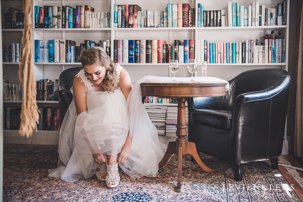 bride getting ready in library