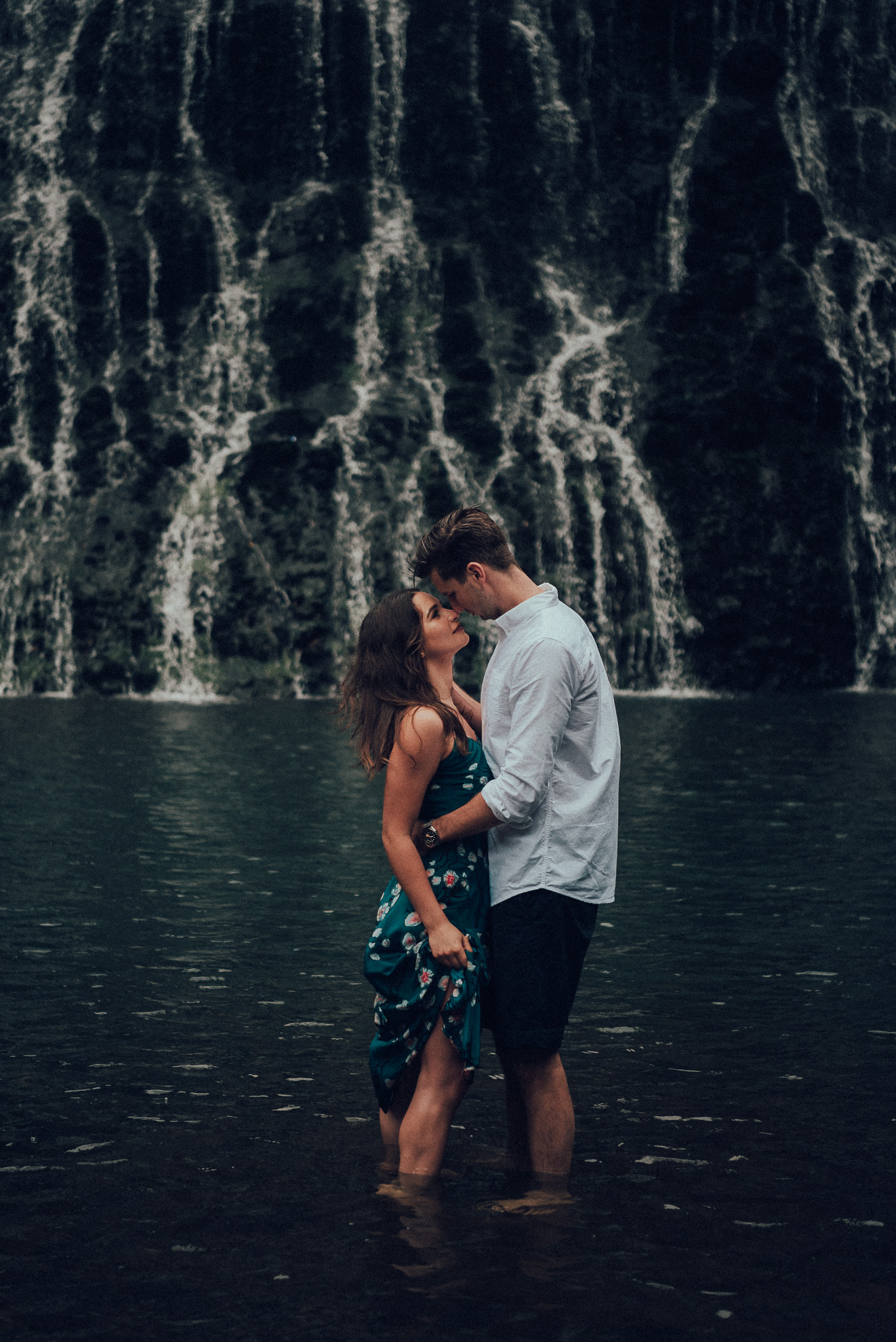 couple standing in the water - lake at Karekare Falls {wedding photographer in West Auckland}