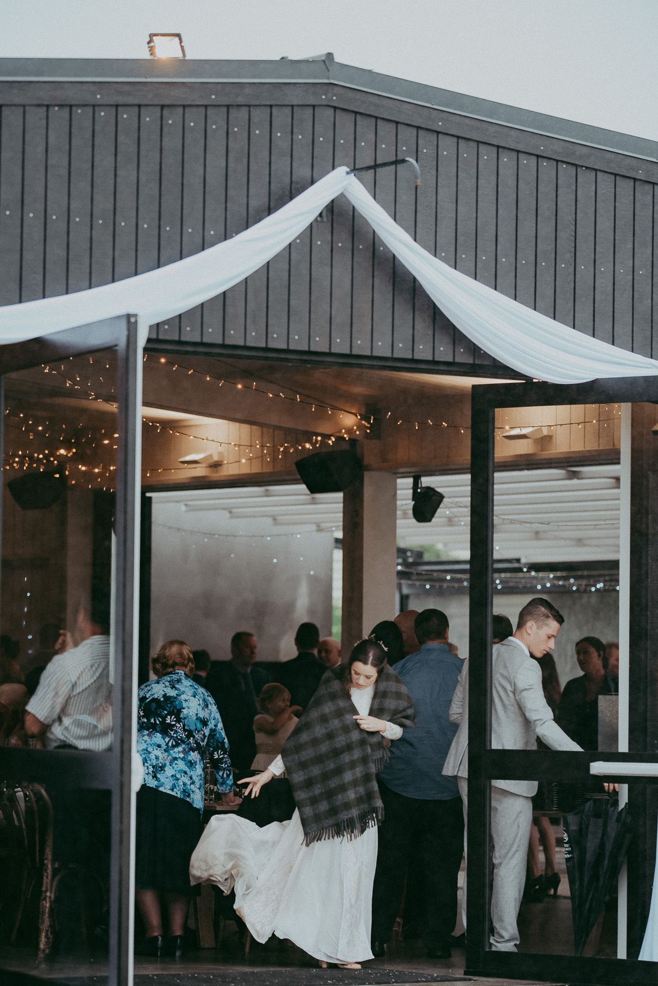 bride and groom entering reception in The Hunting Lodge {Auckland - Kumeu wedding photographer}