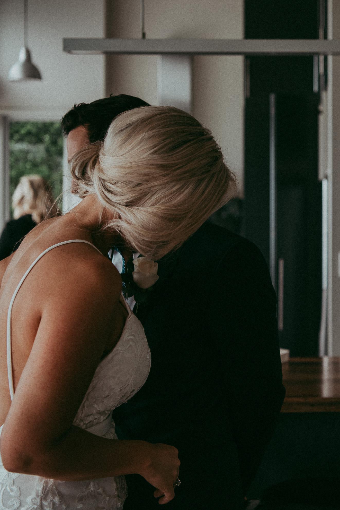 bride and groom candid moment - Waiheke island wedding