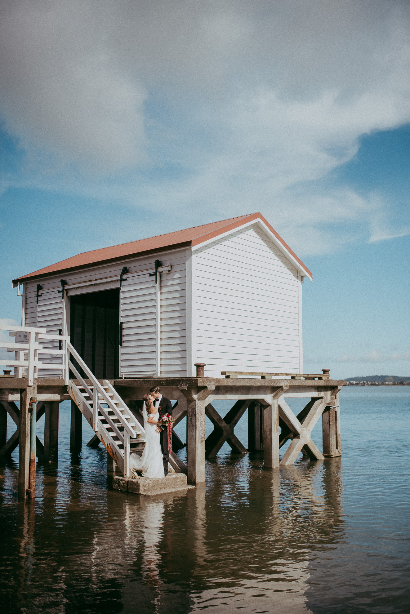 Big Omaha Wharf - bride and groom photos {Matakana - Auckland wedding photographer}