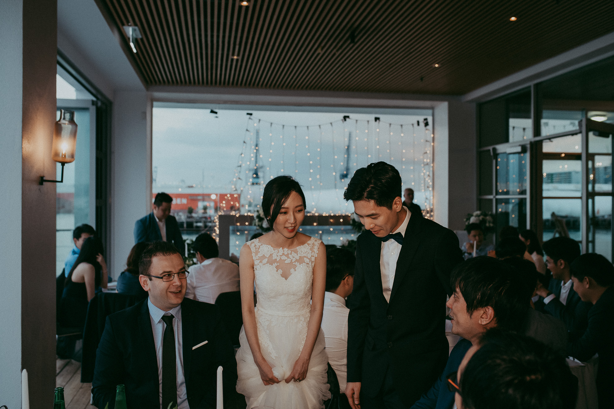 bride and groom at reception with guests