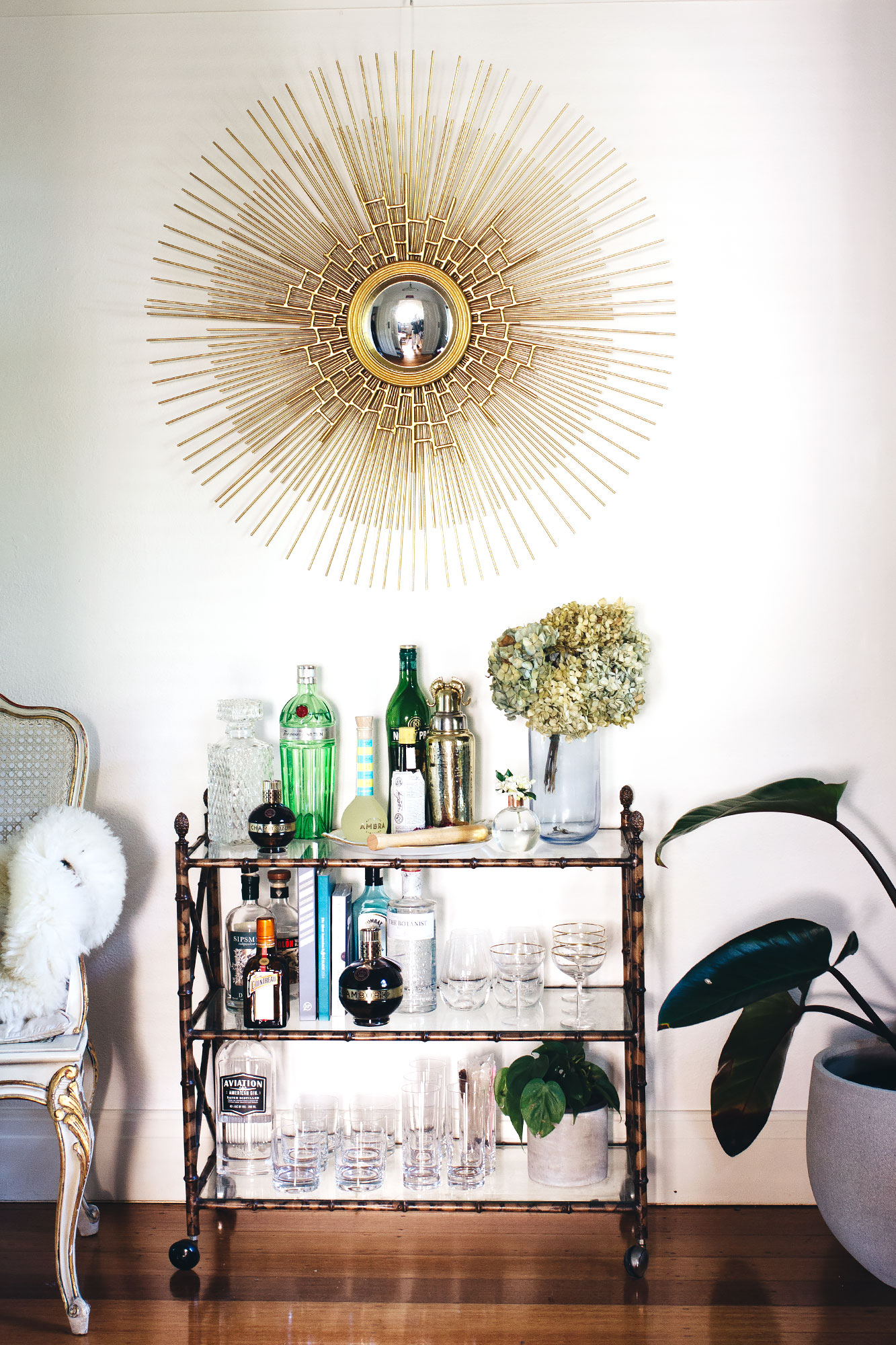 Vintage chair and bar cart,  sunburst mirror from Shine Mirrors .